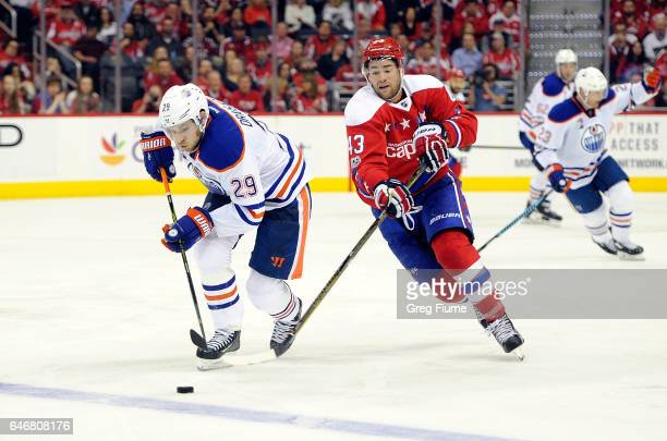 Tom Wilson of the Washington Capitals battles for the puck against Leon Draisaitl of the Edmonton Oilers at Verizon Center on February 24 2017 in...