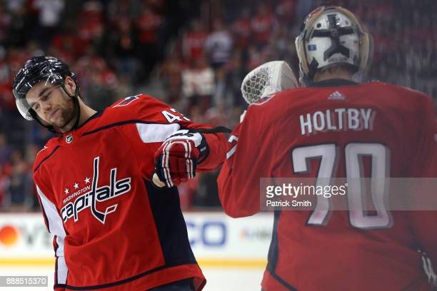Tom Wilson of the Washington Capitals celebrates a goal against the Chicago Blackhawks with Braden Holtby during the first period at Capital One...