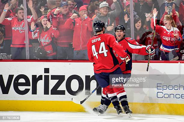 Tom Wilson of the Washington Capitals celebrates his third period goal with his teammate Brooks Orpik during their game against the Columbus Blue...
