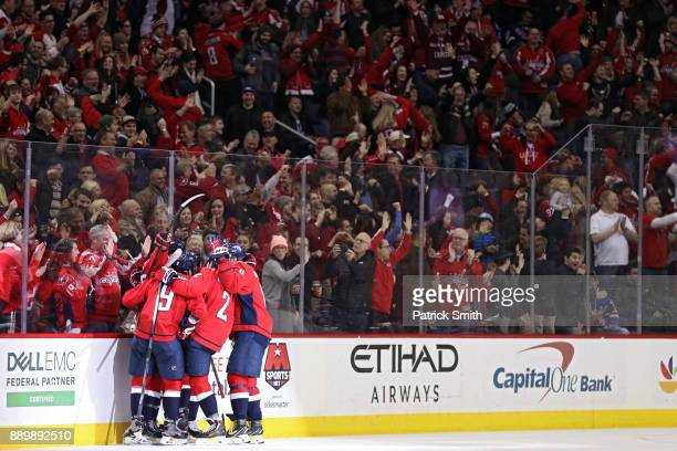 Tom Wilson of the Washington Capitals celebrates with teammates after scoring against the New York Rangers during the third period at Capital One...