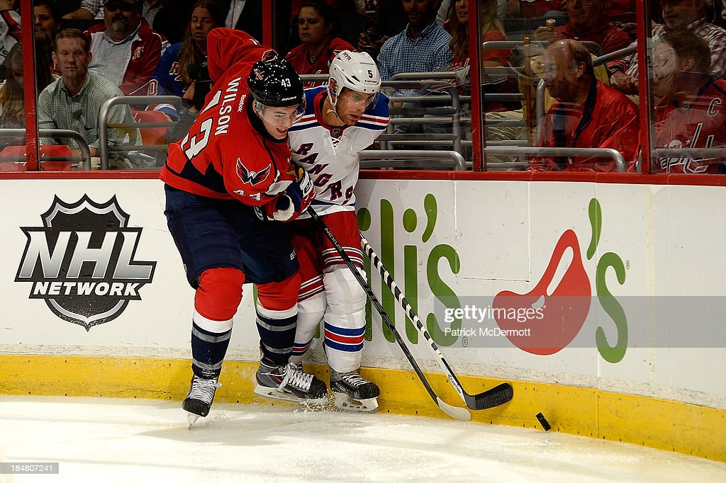 Tom Wilson #43 of the Washington Capitals checks <a gi-track='captionPersonalityLinkClicked' href=/galleries/search?phrase=Anton+Stralman&family=editorial&specificpeople=2271901 ng-click='$event.stopPropagation()'>Anton Stralman</a> #6 of the New York Rangers into the boards during the second period of an NHL game at Verizon Center on October 16, 2013 in Washington, DC.