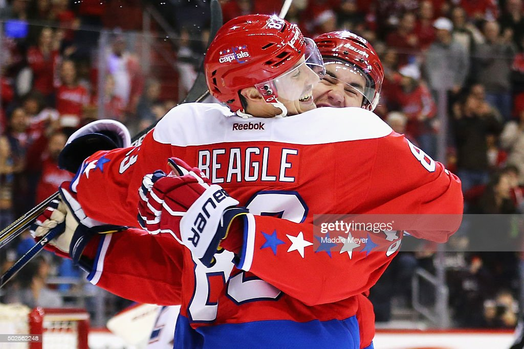 Tom Wilson #43 of the Washington Capitals congratulates Jay Beagle #83 after he scored against the Montreal Canadiens during the second period at Verizon Center on December 26, 2015 in Washington, DC.