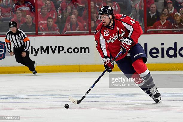 Tom Wilson of the Washington Capitals controls the puck against the New York Islanders during the second period in Game Seven of the Eastern...