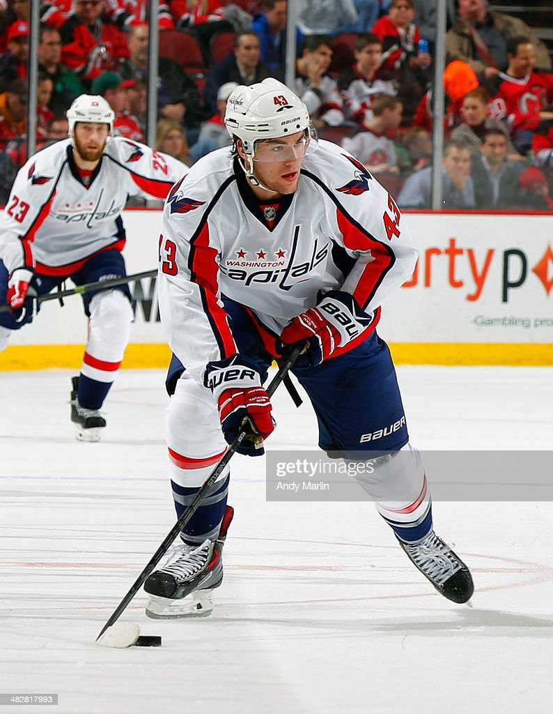 Tom Wilson #43 of the Washington Capitals controls the puck during game action against the New Jersey Devils at the Prudential Center on April 4, 2014 in Newark, New Jersey.