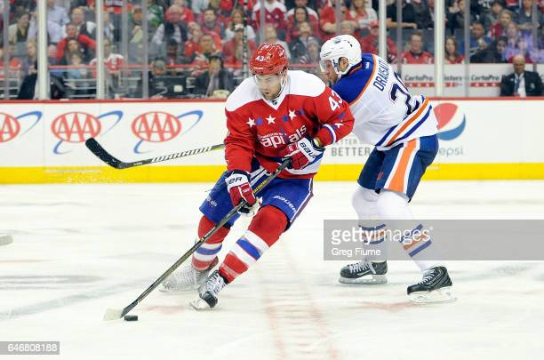 Tom Wilson of the Washington Capitals handles the puck against Leon Draisaitl of the Edmonton Oilers at Verizon Center on February 24 2017 in...