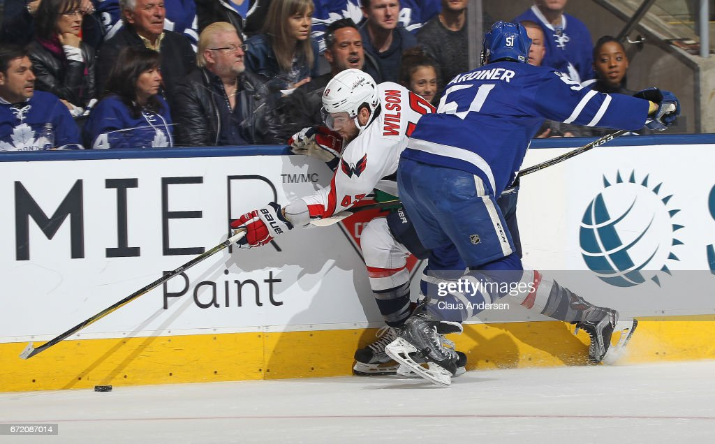 Tom Wilson #43 of the Washington Capitals is squeezed into the boards by Jake Gardiner #51 of the Toronto Maple Leafs in Game Six of the Eastern Conference Quarterfinals during the 2017 NHL Stanley Cup Playoffs at the Air Canada Centre on April 23, 2017 in Toronto, Ontario, Canada. The Capitals defeated the Maple Leafs 2-1 in overtime to win series 4-2.