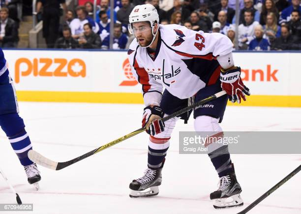 Tom Wilson of the Washington Capitals lines up for a faceoff against the Toronto Maple Leafs during the first period in Game Four of the Eastern...