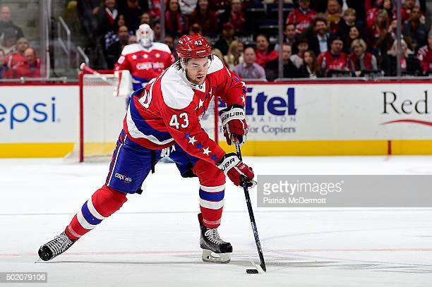 Tom Wilson of the Washington Capitals moves the puck up ice against the Ottawa Senators in the first period during an NHL game at Verizon Center on...