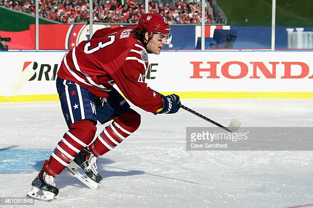 Tom Wilson of the Washington Capitals plays against the Chicago Blackhawks in the 2015 Bridgestone NHL Winter Classic on January 1 2015 at Nationals...