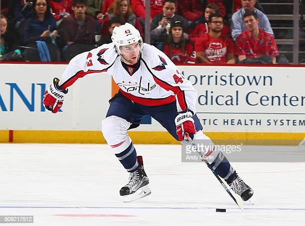 Tom Wilson of the Washington Capitals plays the puck during the game against the New Jersey Devils at the Prudential Center on February 6 2016 in...