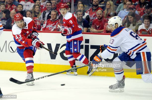 Tom Wilson of the Washington Capitals shoots and scores in the first period against the Edmonton Oilers at Verizon Center on February 24 2017 in...