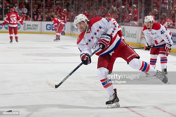 Tom Wilson of the Washington Capitals shoots the puck in warmups before a NHL game against the Detroit Red Wings on April 5 2015 at Joe Louis Arena...
