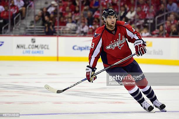Tom Wilson of the Washington Capitals skates against the New Jersey Devils in the third period during the Capitals NHL season opener at Verizon...