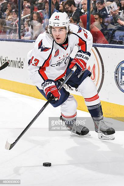 Tom Wilson of the Washington Capitals skates with the puck against the Columbus Blue Jackets on December 18 2014 at Nationwide Arena in Columbus Ohio...