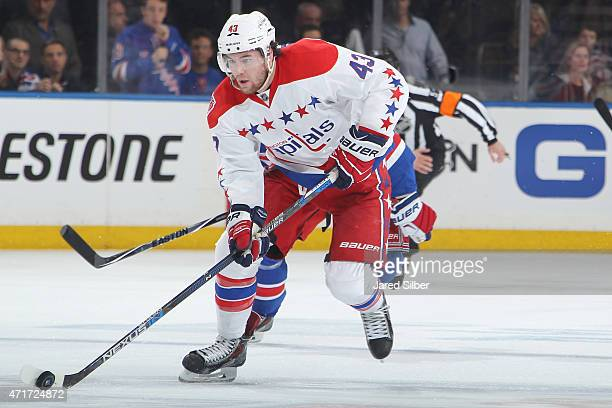 Tom Wilson of the Washington Capitals skates with the puck against the New York Rangers in Game One of the Eastern Conference Semifinals during the...