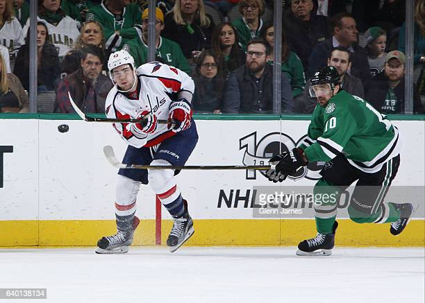 Tom Wilson of the Washington Capitals tries to keep the puck away against Patrick Sharp of the Dallas Stars at the American Airlines Center on...