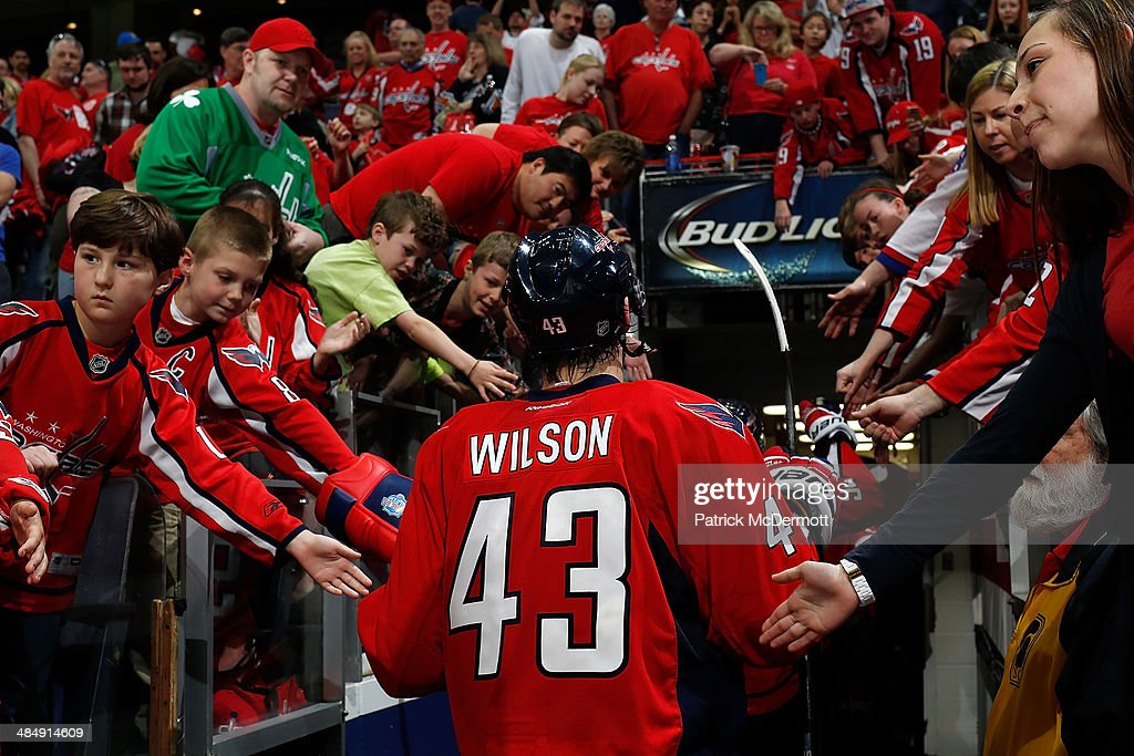 Tom Wilson #43 of the Washington Capitals walks to the locker room after the Tampa Bay Lightning defeated the Washington Capitals 1-0 in a shootout during an NHL game at Verizon Center on April 13, 2014 in Washington, DC.
