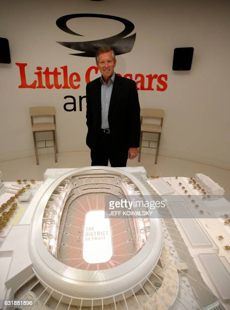 Tom Wilson President CEO of Olympia Entertainment stands before a model of Little Caesars Arena under construction that will be home to the NBA's...