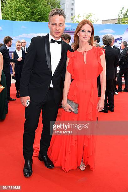 Tom Wlaschiha and Esther Schweins attend the Lola German Film Award 2016 Red Carpet Arrivals on May 27 2016 in Berlin Germany