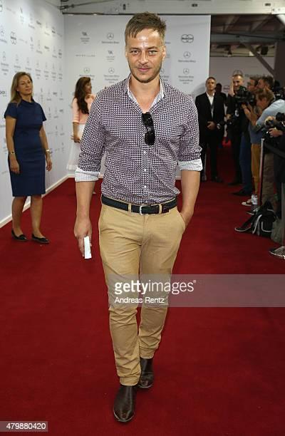 Tom Wlaschiha attends the Minx by Eva Lutz show during the MercedesBenz Fashion Week Berlin Spring/Summer 2016 at Brandenburg Gate on July 8 2015 in...