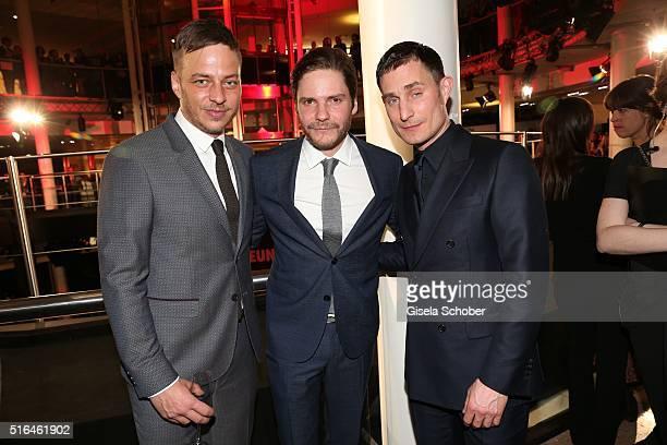 Tom Wlaschiha Daniel Bruehl and Clemens Schick during the 'Vogue loves Breuninger' fashion event on March 18 2016 in Stuttgart Germany
