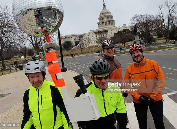 Tom Wood Jesse Freeman Bill English and Mark Ostrow in front of the US Capitol on their weekly ride through town rain or shine on February 2013 in...