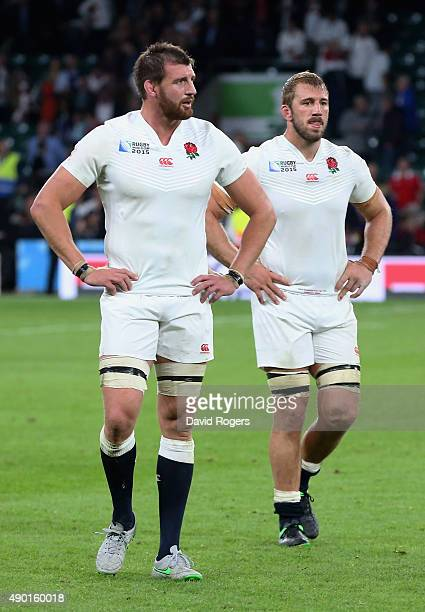 Tom Wood of England and Chris Robshaw of England walk off dejected after the Wales victory during the 2015 Rugby World Cup Pool A match between...