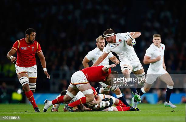 Tom Wood of England attempts to beat the tackle of Dan Lydiate of Wales during the 2015 Rugby World Cup Pool A match between England and Wales at...