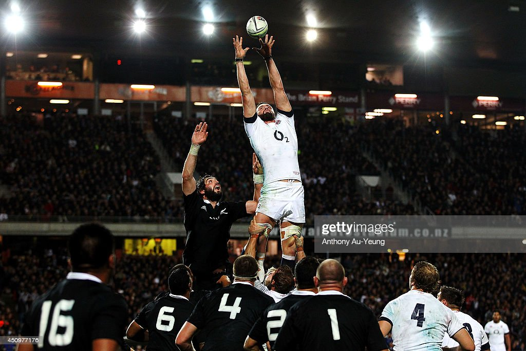 Tom Wood of England competes at the lineout against Sam Whitelock of New Zealand during the International Test match between the New Zealand All...