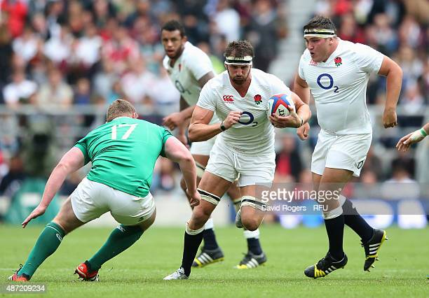 Tom Wood of England is challenged by Tadhg Furlong of Ireland during the QBE International match between England and Ireland at Twickenham Stadium on...