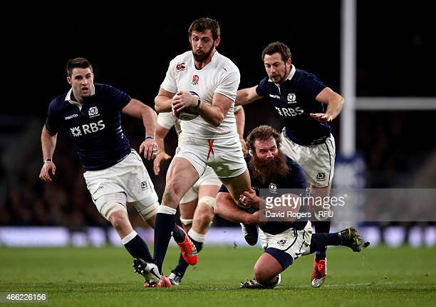 Tom Wood of England is tackled by Geoff Cross of Scotland during the RBS Six Nations match between England and Scotland at Twickenham Stadium on...