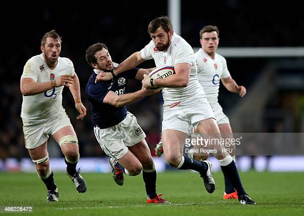 Tom Wood of England is tackled by Greig Laidlaw of Scotland during the RBS Six Nations match between England and Scotland at Twickenham Stadium on...
