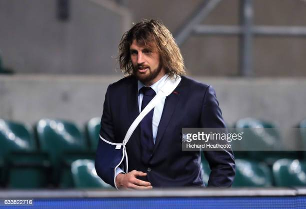 Tom Wood of England leaves with his arm in a sling after the RBS Six Nations match between England and France at Twickenham Stadium on February 4...