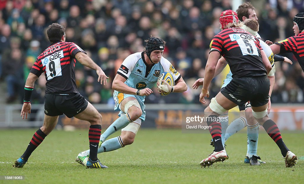 Tom Wood of Northampton breaks with the ball during the Aviva Premiership match between Saracens and Northampton Saints at stadiumMK on December 30, 2012 in Milton Keynes, England.