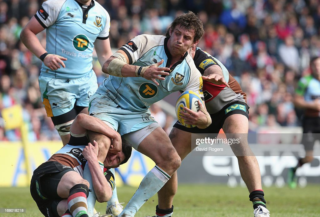 Tom Wood of Northampton is tackled by Tom Casson and <a gi-track='captionPersonalityLinkClicked' href=/galleries/search?phrase=Nick+Easter&family=editorial&specificpeople=686040 ng-click='$event.stopPropagation()'>Nick Easter</a> during the Aviva Premiership match between Harlequins and Northampton Saints at Twickenham Stoop on May 4, 2013 in London, England.
