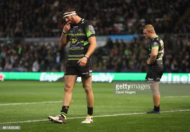Tom Wood of Northampton looks dejected after their defeat during the European Rugby Champions Cup match between Northampton Saints and Saracens at...