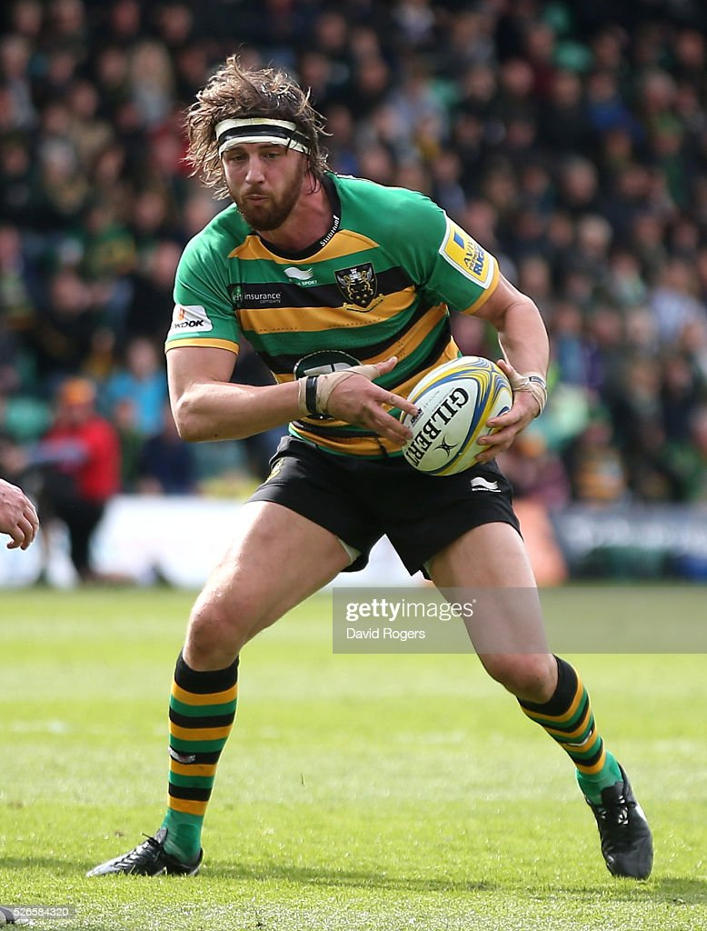 Tom Wood of Northampton runs with the ball during the Aviva Premiership match between Northampton Saints and Bath at Franklin's Gardens on April 30, 2016 in Northampton, England.