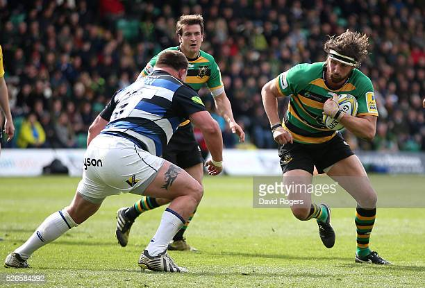 Tom Wood of Northampton runs with the ball during the Aviva Premiership match between Northampton Saints and Bath at Franklin's Gardens on April 30...