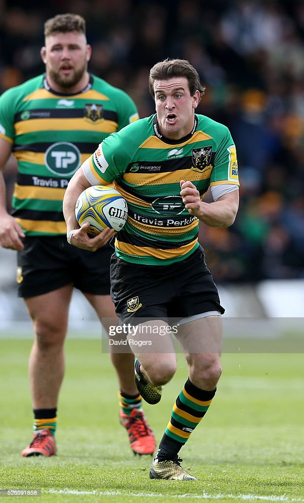 <a gi-track='captionPersonalityLinkClicked' href=/galleries/search?phrase=Tom+Wood+-+Rugby+Player&family=editorial&specificpeople=7472332 ng-click='$event.stopPropagation()'>Tom Wood</a> of Northampton runs with the ball during the Aviva Premiership match between Northampton Saints and Bath at Franklin's Gardens on April 30, 2016 in Northampton, England.