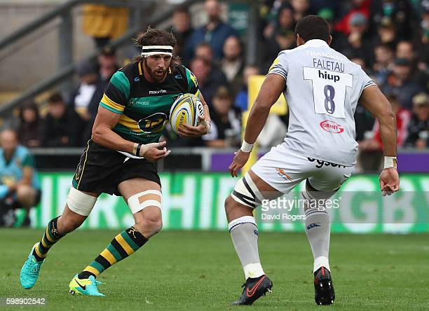 Tom Wood of Northampton runs with the ball during the Aviva Premiership match between Northampton Saints and Bath at Franklin's Gardens on September...