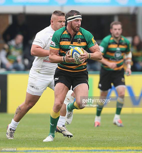 Tom Wood of Northampton runs with the ball during the Aviva Premiership play off semi final match between Northampton Saints and Saracens at...