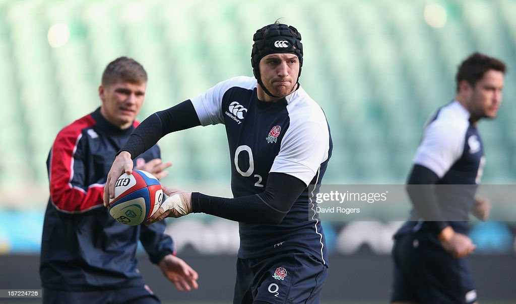 Tom Wood passes the ball during the England captain's run at Twickenham Stadium on November 30, 2012 in London, England.