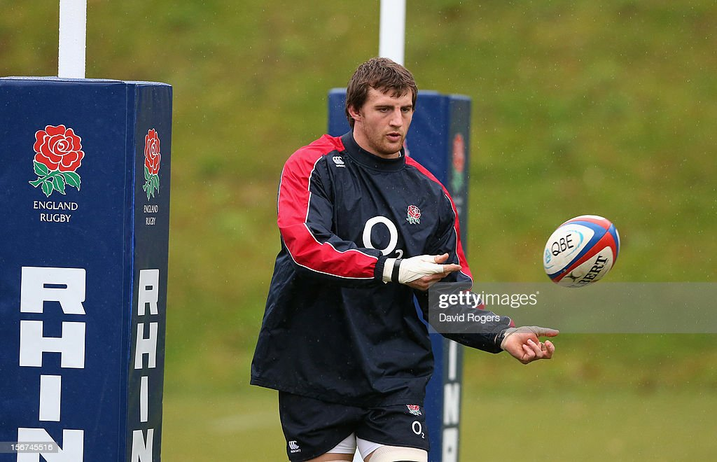 Tom Wood passes the ball during the England training session held at Pennyhill Park on November 20, 2012 in Bagshot, England.