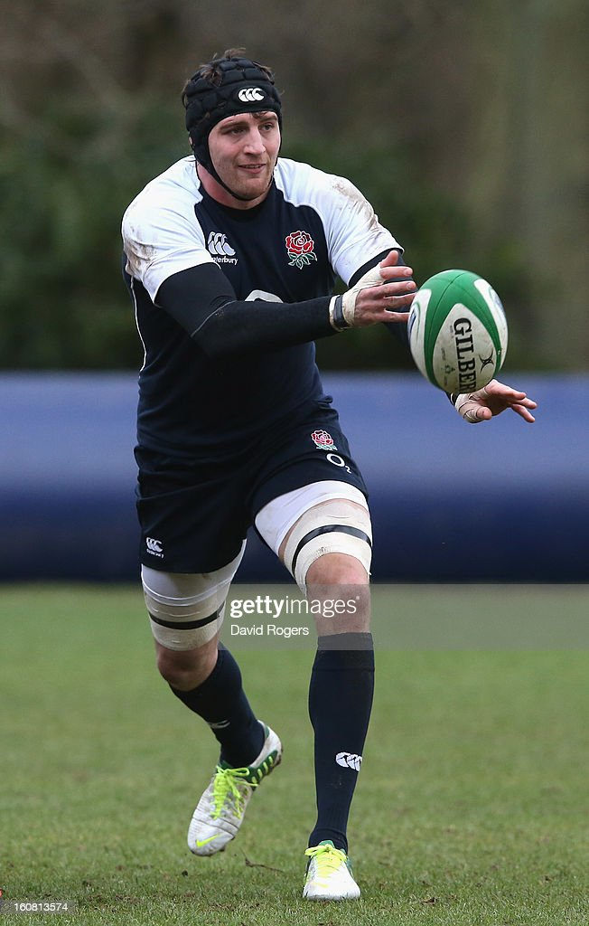 Tom Wood passes the ball during the England training session held at Pennyhill Park on February 6, 2013 in Bagshot, England.