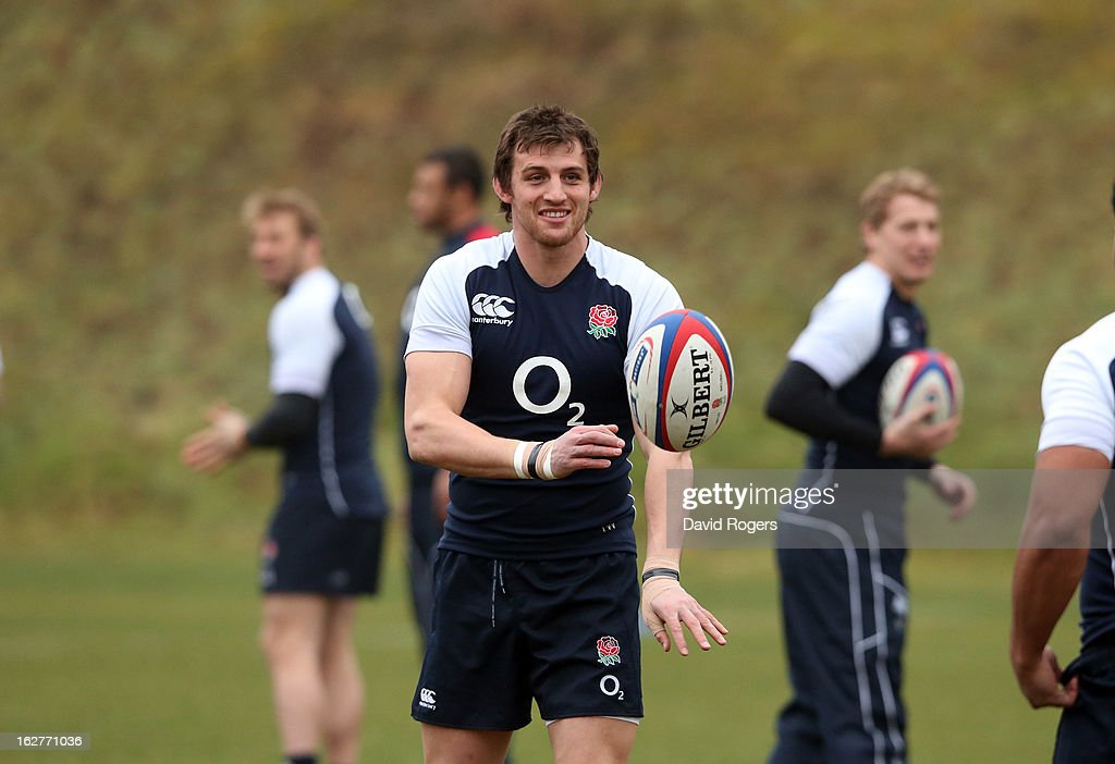 Tom Wood passes the ball during the England training session held at Pennyhill Park on February 26, 2013 in Bagshot, England.
