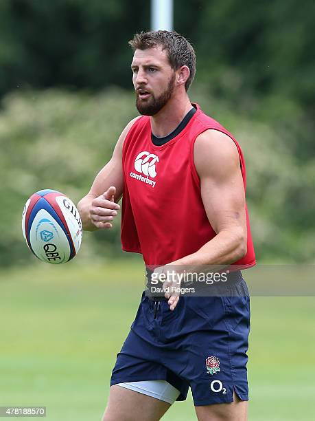 Tom Wood passes the ball during the England training session held at Pennyhill Park on June 23 2015 in Bagshot England