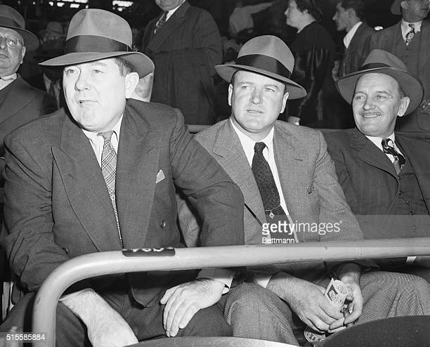 Tom Yawkey and Joe Cronin respective owner and club manager of the Boston Red Sox watch the Brooklyn Dodgers and St Louis Cardinals at Ebbets Field...