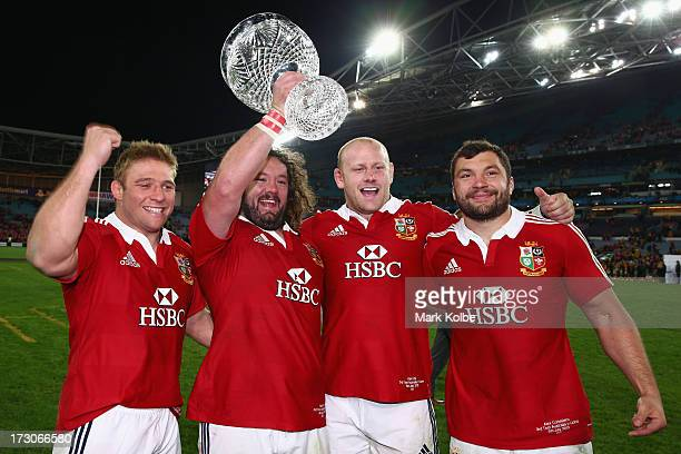 Tom Youngs Adam Jones Dan Cole and Alex Corbisiero of the Lions celebrate with the trophy after victory during the International Test match between...