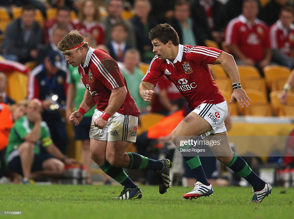Tom Youngs (L) and his brother Ben Youngs of the Lions race after the loose ball during the First Test match between the Australian Wallabies and the British & Irish Lions at Suncorp Stadium on June 22, 2013 in Brisbane, Australia.