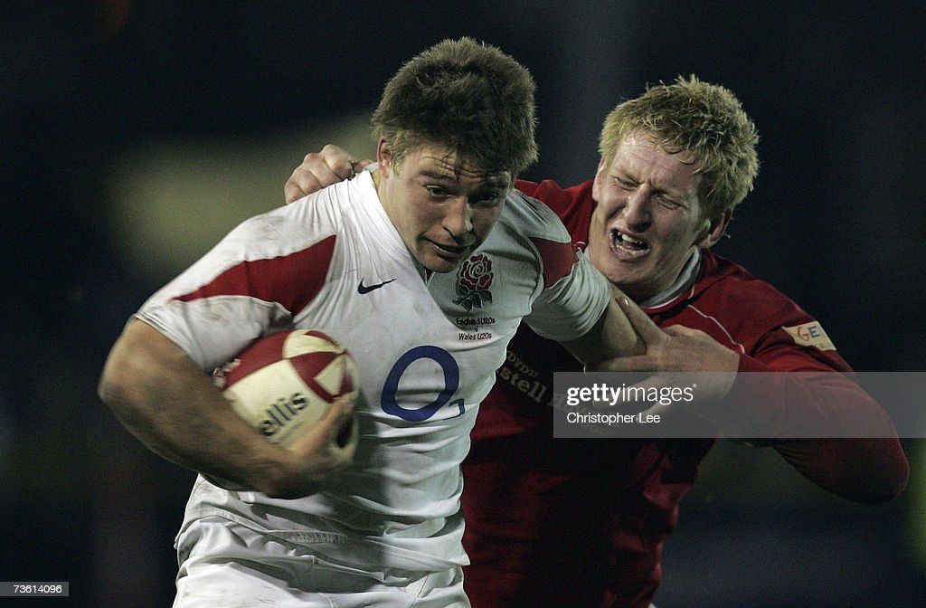 Tom Youngs of England gets away from Bradley Davies of Wales during the International Friendly match between Wales U20 and England U20 at Rodney...